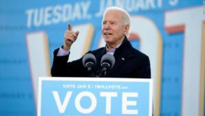 ©Carolyn Kaster/AP President-elect Joe Biden speaks in Atlanta, Monday, Jan. 4, 2021, as he campaigns for Senate candidates Raphael Warnock and Jon Ossoff.