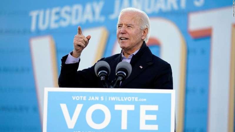©Carolyn Kaster/AP President-elect Joe Biden speaks in Atlanta, Monday, Jan. 4, 2021, as he campaigns for Senate candidates Raphael Warnock and Jon Ossoff.