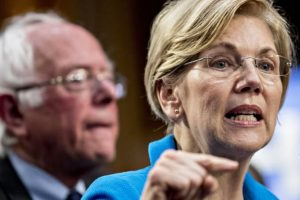 Senator Elizabeth Warren speaks as Senator Bernie Sanders looks on.Andrew Harrer | Bloomberg | Getty Images