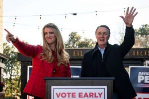 © Al Drago/Reuters Senators Kelly Loeffler (R., Ga.) and David Perdue (R., Ga.), wave during a campaign event in Milton, Ga., December 21, 2020.
