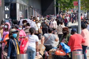 Hundreds of people line up for a free food distribution event held by the Food Bank of New York at Barclays Center in Brooklyn, New York on Friday, May 15, 2020. (Gardiner Anderson/for New York Daily News)