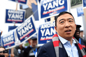 Andrew Yang greets supporters at the New Hampshire Democratic Party state convention in Manchester, N.H. (Gretchen Ertl/Reuters)
