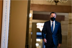 Sen. Mitt Romney (R-UT) heads to the floor of the Senate on January 26, 2021 in Washington, DC. Photo by Samuel Corum/Getty Images