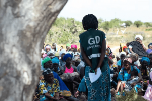 A GiveDirectly staffer conducts an introductory community meeting in a rural Kenyan village.
