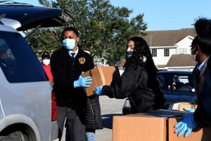 Volunteers load boxes of food assistance into cars at the Share Your Christmas food distribution event sponsored by the Second Harvest Food Bank of Central Florida, Faith Neighborhood Center, and WESH 2 at Hope International Church on December 9, 2020 in Groveland, Florida, near Orlando. Central Florida food banks struggle to serve those facing food insecurity during the holiday season amid the COVID-19 pandemic. Photo by Paul Hennessy/NurPhoto via Getty Images