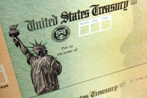 Progressives say President Joe Biden must go further on stimulus checks, which remain overwhelmingly popular with the public. | Matt Rourke, File/AP Photo