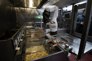Flippy the robot running a fry station at Miso Robotics' test kitchen in January in Pasadena.(Gina Ferazzi/Los Angeles Times)