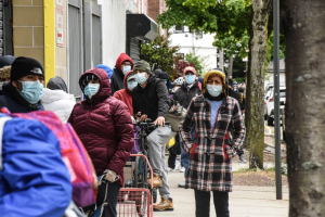 People wait in line to receive food donated by SOMOS, in partnership with World Central Kitchen and Maestro Cares Foundation, on May 11, 2020 in the Elmhurst neighborhood of Queens in New York City. Stephanie Keith / Getty