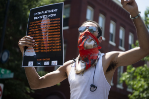 Demonstrators rally near Capitol Hill for the extension of unemployment benefits on July 22, 2020. Nearly a year later, workers' benefits are in flux again, even as the economy is far from recovered. Tom Williams/CQ-Roll Call Inc. via Getty Images