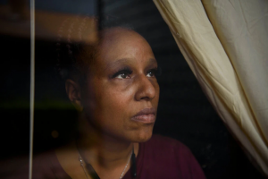 Chenetta Ray, a warehouse worker at a recycling company in Houston, had an unforgiving budget even before business closures reduced trash collection and cut her hours by a third. The stimulus checks helped her afford to treat her cancer. Credit...Callaghan O'Hare for The New York Times