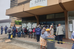 Queues at a South African Social Security Agency (SASSA) office in Bellville in January. The reinstatement of the Covid-19 grant takes the country one step closer to a universal basic income guarantee, say the authors. (Photo: GroundUp / Mary-Anne Gontsana)