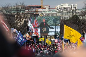 """Donald Trump supporters gather for the """"Stop the Steal"""" rally on Jan. 6, 2021, in Washington, D.C., making their way toward the U.S. Capitol building soon after. Photo by Robert Nickelsberg/Getty Images"""