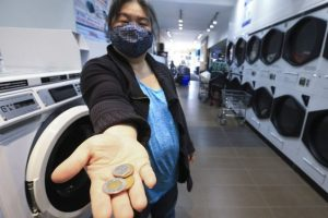 Nancy Seto who runs and owns Yummi Cafe Laundromat at Oakwood Ave. and St. Clair Ave. W. has created the Free Laundry Access Program for people suffering monetary loss through COVID. She created a GoFundMe page asking only for $1,000 and it is already at $6,263 as of Monday morning. PHOTO BY JACK BOLAND /Jack Boland/Toronto Sun